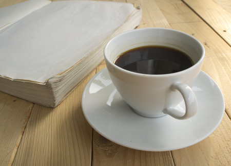ceremic: cup of coffee in morning with a book