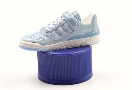 The Figure Model of Adidas Sneakers or Trainers or Shoes on Pepsi Bottle Caps for Collector isolate on White Background
