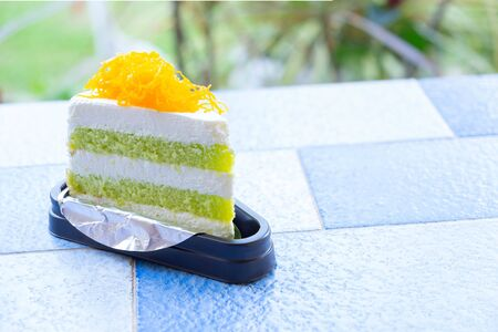 Pandan Cake with golden egg yolk thread on Top on The Table