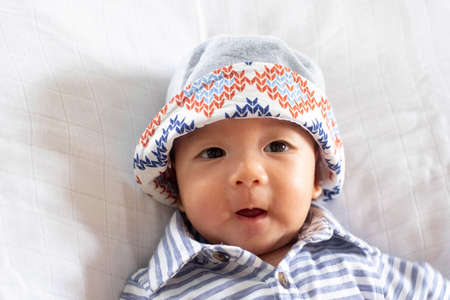 The  Portrait of Asian Baby Infant Boy wearing bucket hat