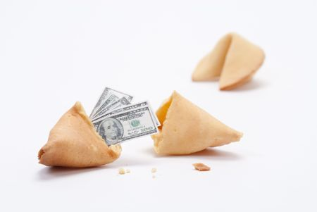 Fortune cookie broken open with miniature cash coming out Stock Photo