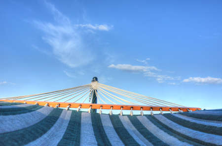 Hammock with blue summer sky and white clouds