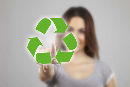 recycle sign: Young woman pointing at recicle icons