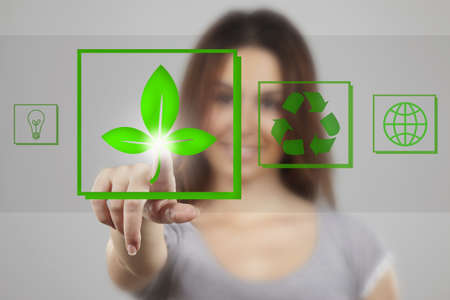Young woman pointing at recicle icons photo