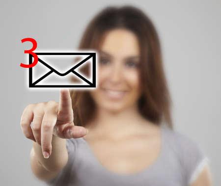 Businesswoman pressing message icon Stock Photo - 16693215