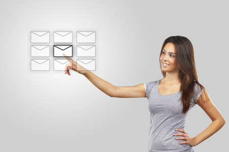 Businesswoman pressing message icon Stock Photo - 16693223