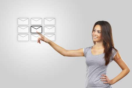 virtual community: Businesswoman pressing message icon Stock Photo