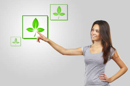 Young woman pointing at recicle icons Stock Photo - 16693219