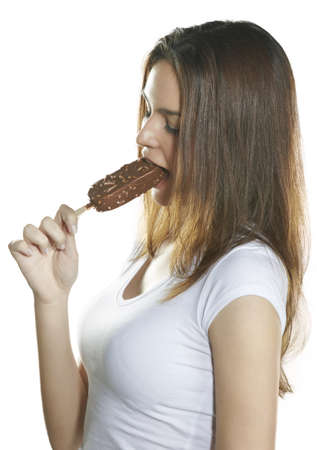 Beautiful young woman eating ice cream