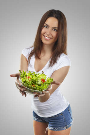 Healthy lovely woman with salad Stock Photo - 16754480