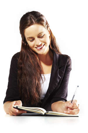 portrait of a young woman writing at work photo