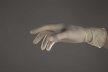 hand with glove on studio photo
