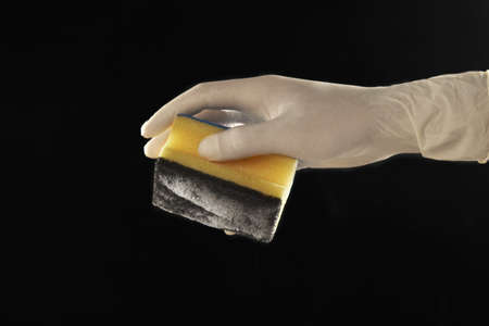 latex glove: still life of a scourer and a latex glove