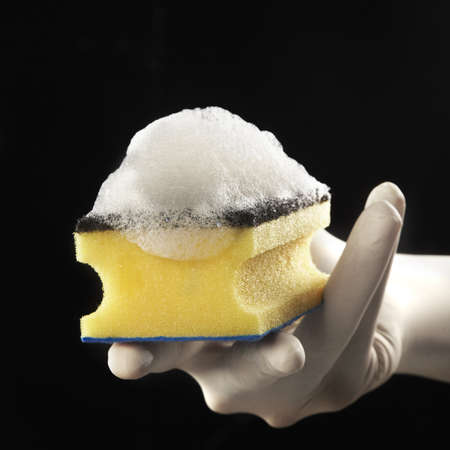 still life of a scourer and a latex glove Stock Photo - 16701752