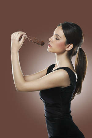 Portrait of beautiful woman over brown background photo