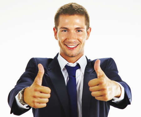 great job: Smiling young business man thumbs up Stock Photo