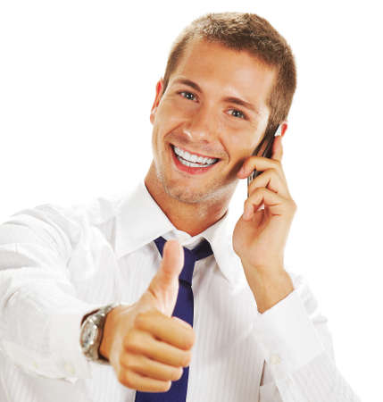 Smiling young businessman with phone photo