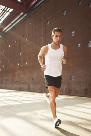 sprinting: Caucasian male athlete doing exercise outdoor