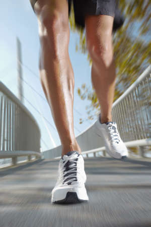 photo of man legs running with motion photo