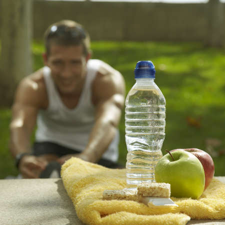 energy drinks: young man doing exercices  Stock Photo