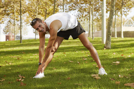 warm up: Young man sports exercises