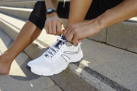 tying: sport man before training