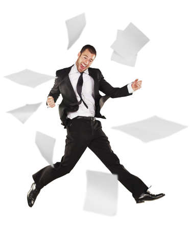 Success business man jumping with work papers photo