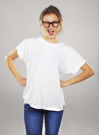 winking: Excited young woman in glasses winking