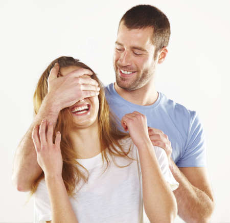 Happy man covering young beautiful girl eyes Stock Photo - 16826681