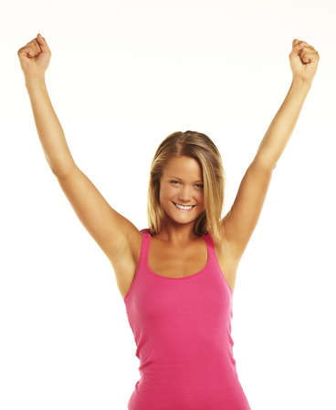 Happy young woman raising hands in joy and freedom photo
