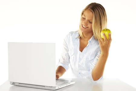 Beautiful young woman using laptop Stock Photo - 16903798
