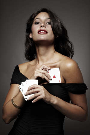 poker cards: sexy woman on gray background