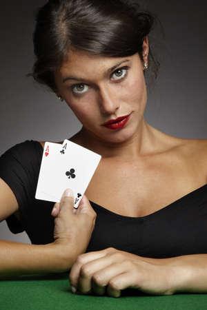 croupier: sexy woman playing poker