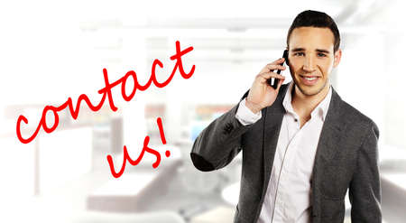 write us: businessman with mobil phone and Contact Us