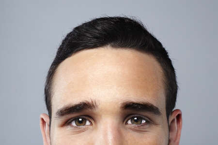 man face close up: Young attractive man face looking camera