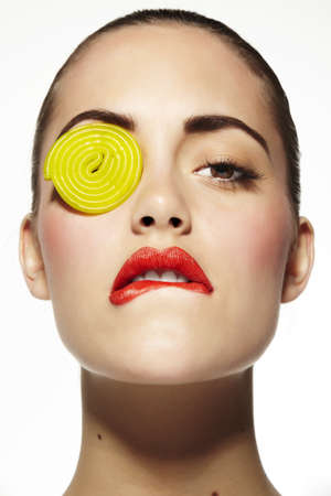 Beauty of a young woman with candy in the eye Stock Photo - 16949182