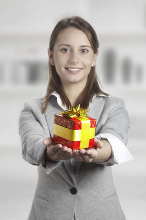 portrait of a beautiful woman with a gift Stock Photo - 16969649