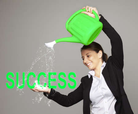 constancy: Beautiful smiling businesswoman - success concept