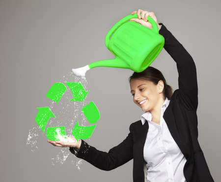 constancy: Beautiful smiling businesswoman - recycling concept Stock Photo