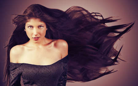 Young brunette woman with long flying hair  Retro stye Stock Photo - 16968820