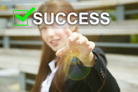 Businesswoman pressing success icon with virtual background photo