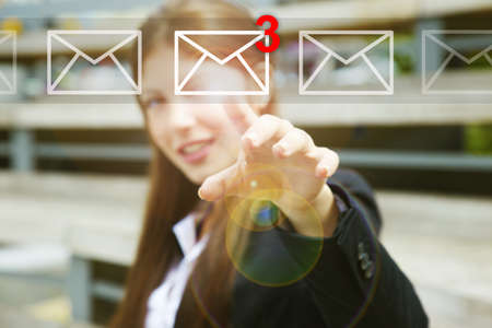 pressing: Businesswoman pressing email icons with virtual background