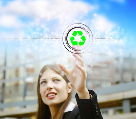 Young businesswoman pushing recycle symbol Stock Photo - 16968827