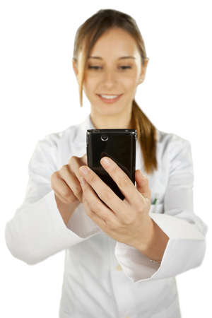 medical woman  with mobile phone over white background Stock Photo