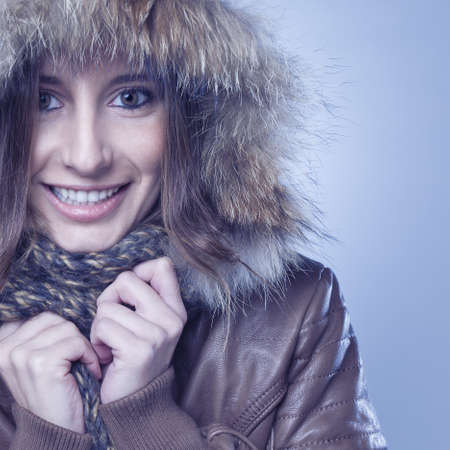 beautiful girl wearing fur lined coat hood and smiling photo