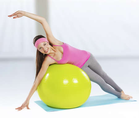 Attractive fit woman pilates exercise isolated Stock Photo