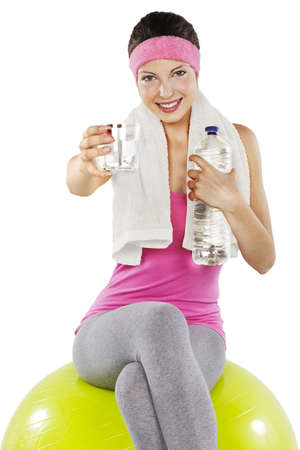 Fitness - woman relax with water bottle exercise ball photo
