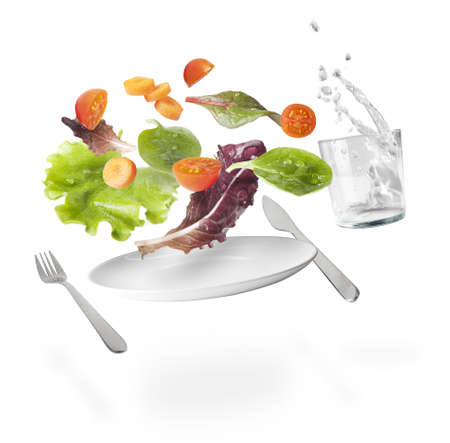 cherry varieties: vegetables,fork, knife, glass of water and dish in suspension