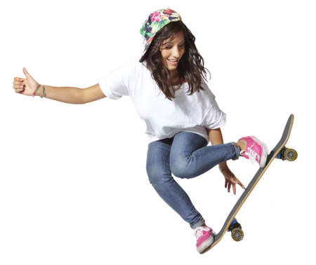 Skateboarder woman jumping showing thumbs up