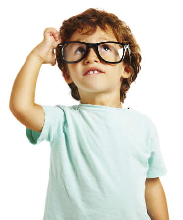 scratching head: little boy scratching his head thinking isolated on white background Stock Photo